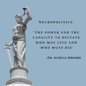 Statue of Justice from Top of New York City Hall with Definition of Necropolitics